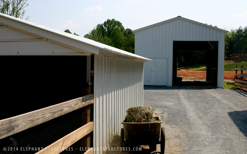 Large metal garage and animal shelter.