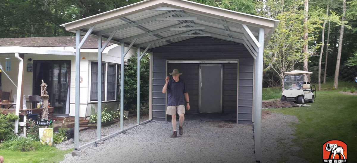 Utility shed carport with roll up garage door and walk in.