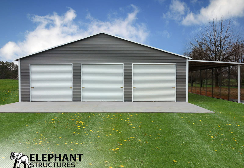 Three roll up garage doors on the front of a steel building used for storage, and an extra lean to on the side.
