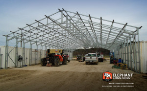 Extra framing with extra wide dimensions of a commercial metal building in the process of an installation.