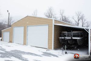 Metal Carport Boat Storage with ridgeline styling and three roll up garage doors.