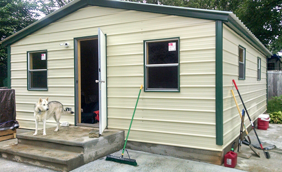 Steel building garage tiny home from the exterior.