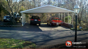 Open carport with two cars stored safely