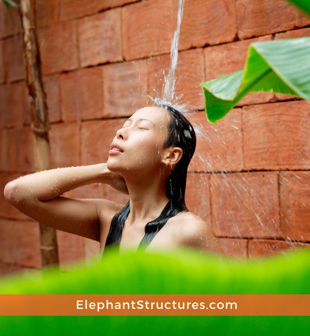 Woman using an outdoor shower for tiny homes